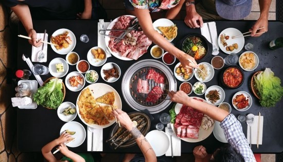 family gathered over korean meal