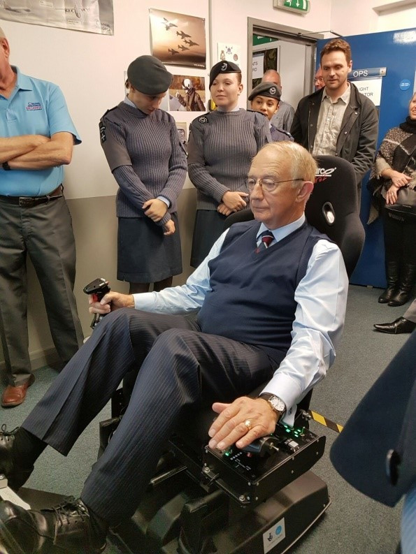 Air Marshall Sir Christopher Colville tries out the simulator at Epsom