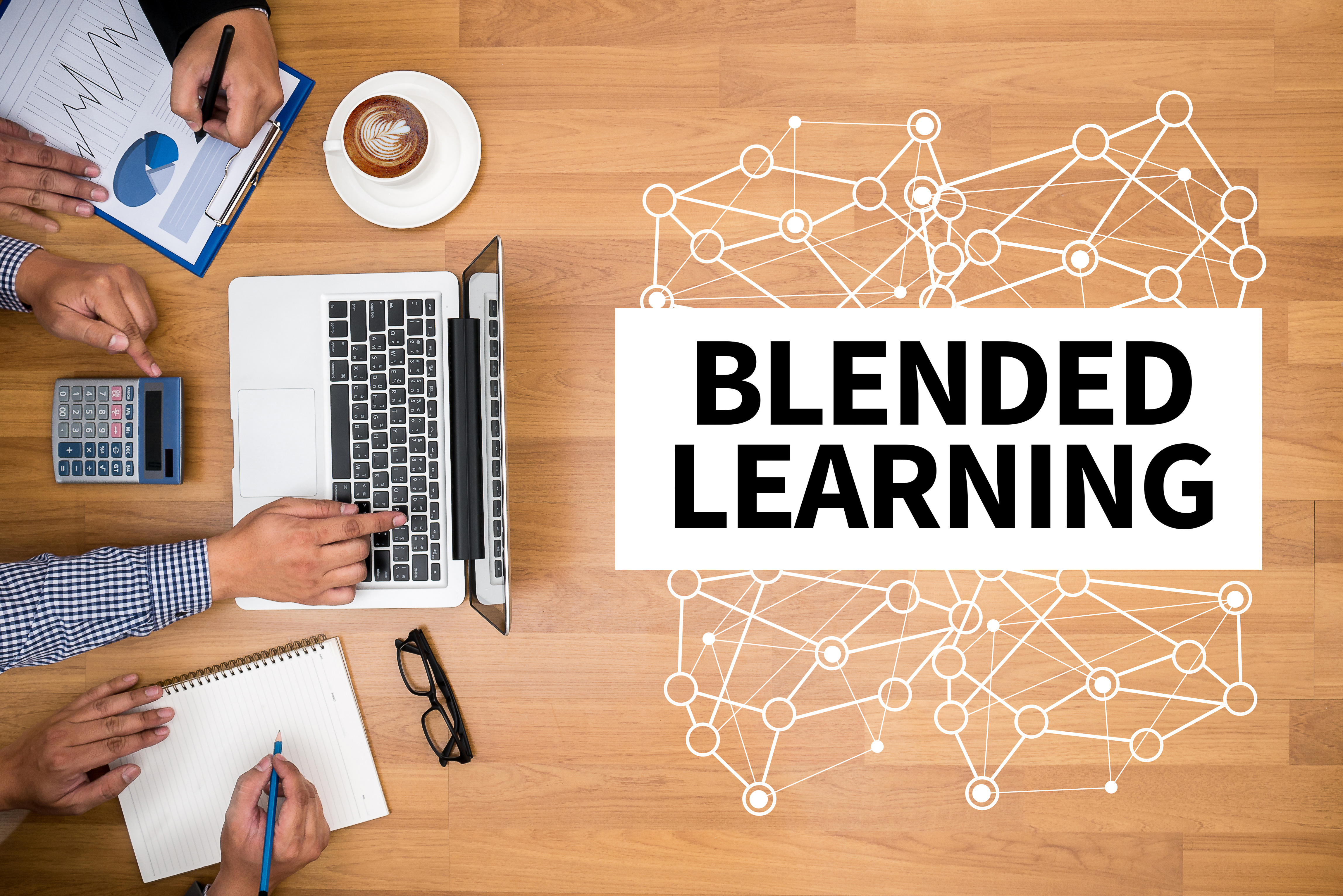 BLENDED LEARNING Business team hands at