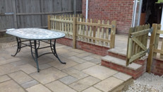 Terraced paving and Patio with Picket Fencing and Gate