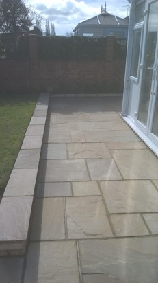 Low Retaining Wall with Natural Stone Capping and Patio