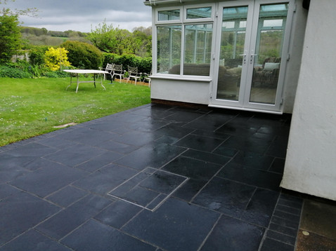 Black Limestone Patio with Block Edging
