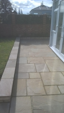 Low Retaining Wall with Natural Stone Coping and Paving