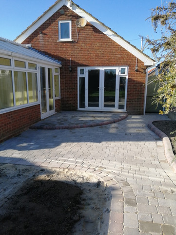 Ash Tumbled Block Paving Patio with Brindle Kerb Step and Raised Bed