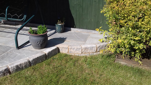 Kandla Grey Natural Stone Paving with Pitch Faced Block Edging