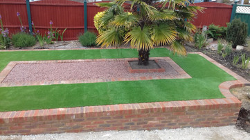 Artificial Grass with Brick Edging and Wall