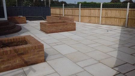 Rustic Pearl Natural Stone Paving with 9'' Brick Planters