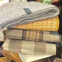 A new stack of _tartanblanketco just waiting for your home! Love the knitted blankets- couldn't deci