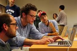 group of guys doing test on laptop.jpg