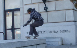 skateboarder at the opera house.lores.crop