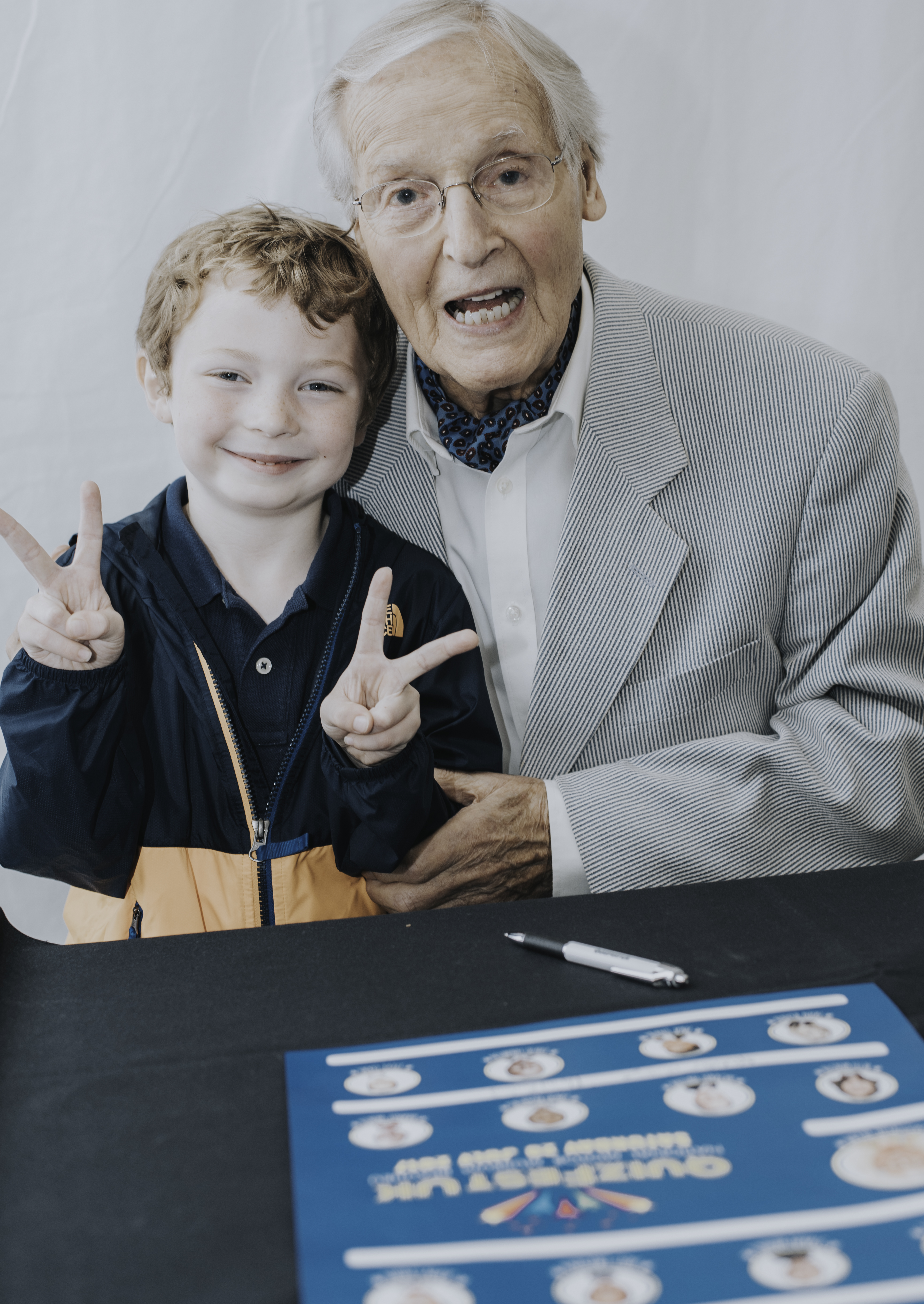 Nicholas Parsons with young fan