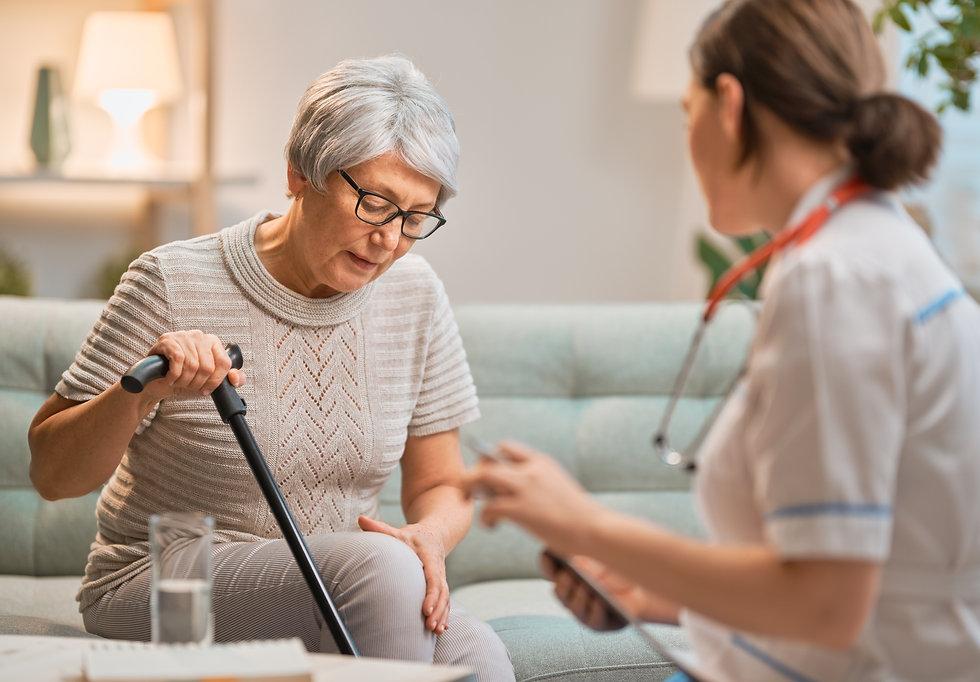 elderly-patient-and-caregiver-LRX4SRX.jp