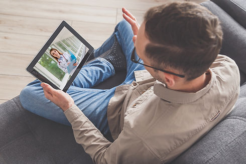 man-connects-with-doctor-by-pc-tablet-in