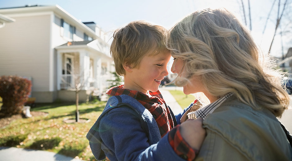 Blonde Mother and Son in neighborhood