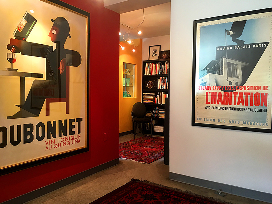 Vintage posters welcome visitors to the studio