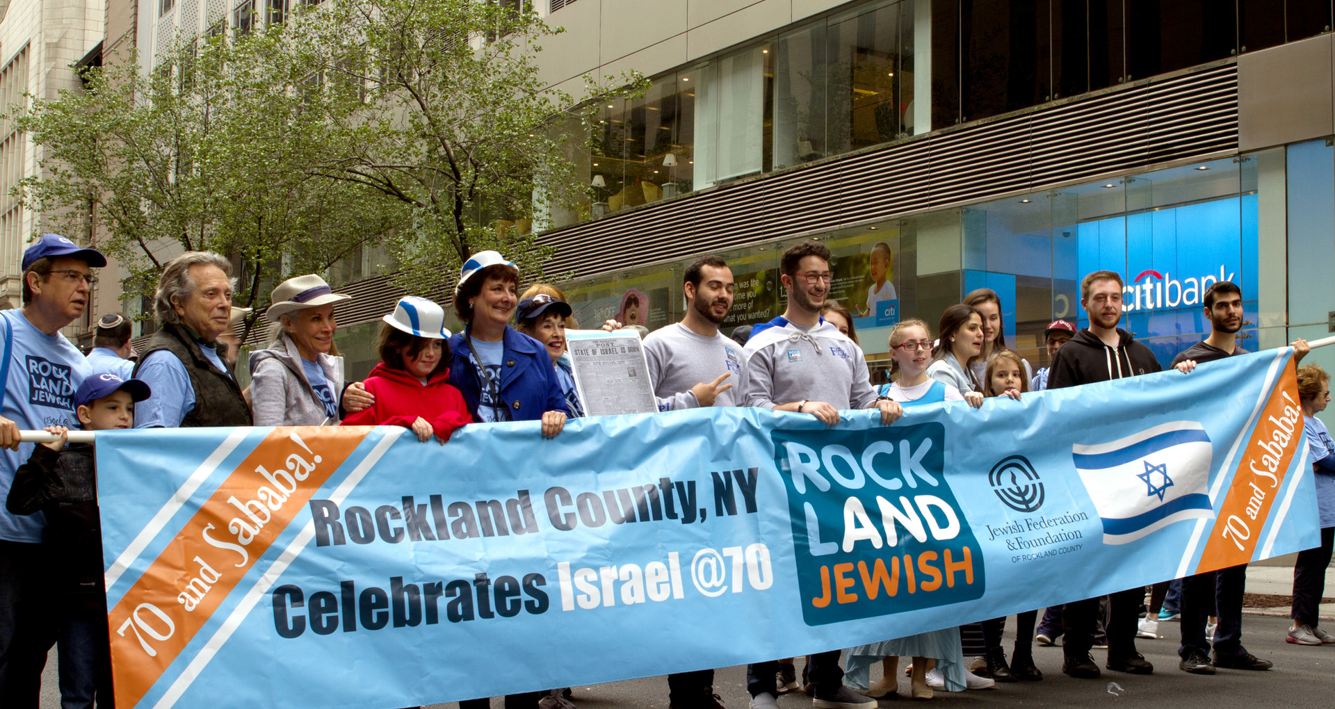 Rockland parade marchers with branded banner