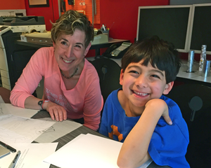 Beth Singer and Noah viewing logo studies
