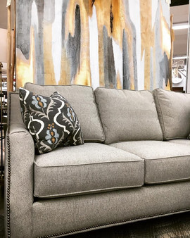 Gray hickorycraft sofa with nailhead trim