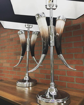Black and silver lamps with horns