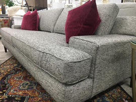 Mid Mod gray sofa with magenta pillows