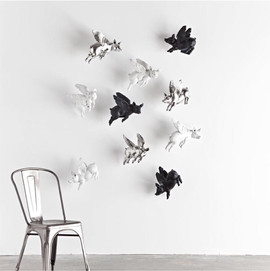 Black and White flying pigs by a dining chair