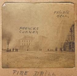 Fire drill with the Sockanossett pumper in Market Square, Houlton, ca. 1880.