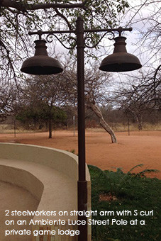 2 STEELWORKERS ON STRAIGHT ARM WITH S CURL ON AN AMBIENTE LUCE STEEL POLE AT A PRIVATE GAME LODGE