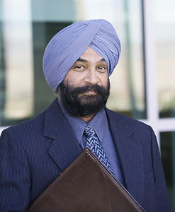 Portrait of a serious Indian Businessman with folder_edited.jpg
