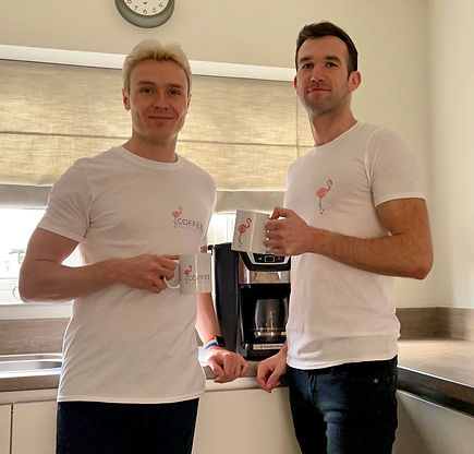 Owners Dan and James. Pose with branded cups and t-shirts.
