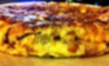 1200px-Tortilla_de_patata_y_cebolla.JPG