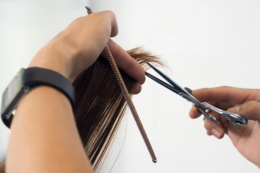 person cutting hair