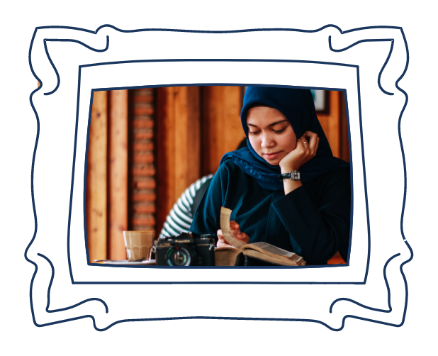 Woman wearing hijab reading a book in a white photo frame