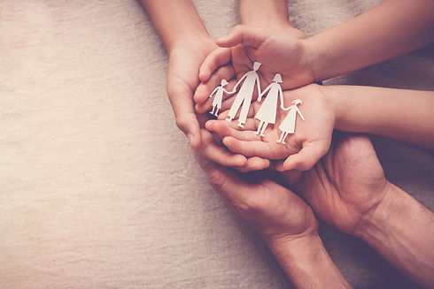 adult-children-hands-holding-paper-famil