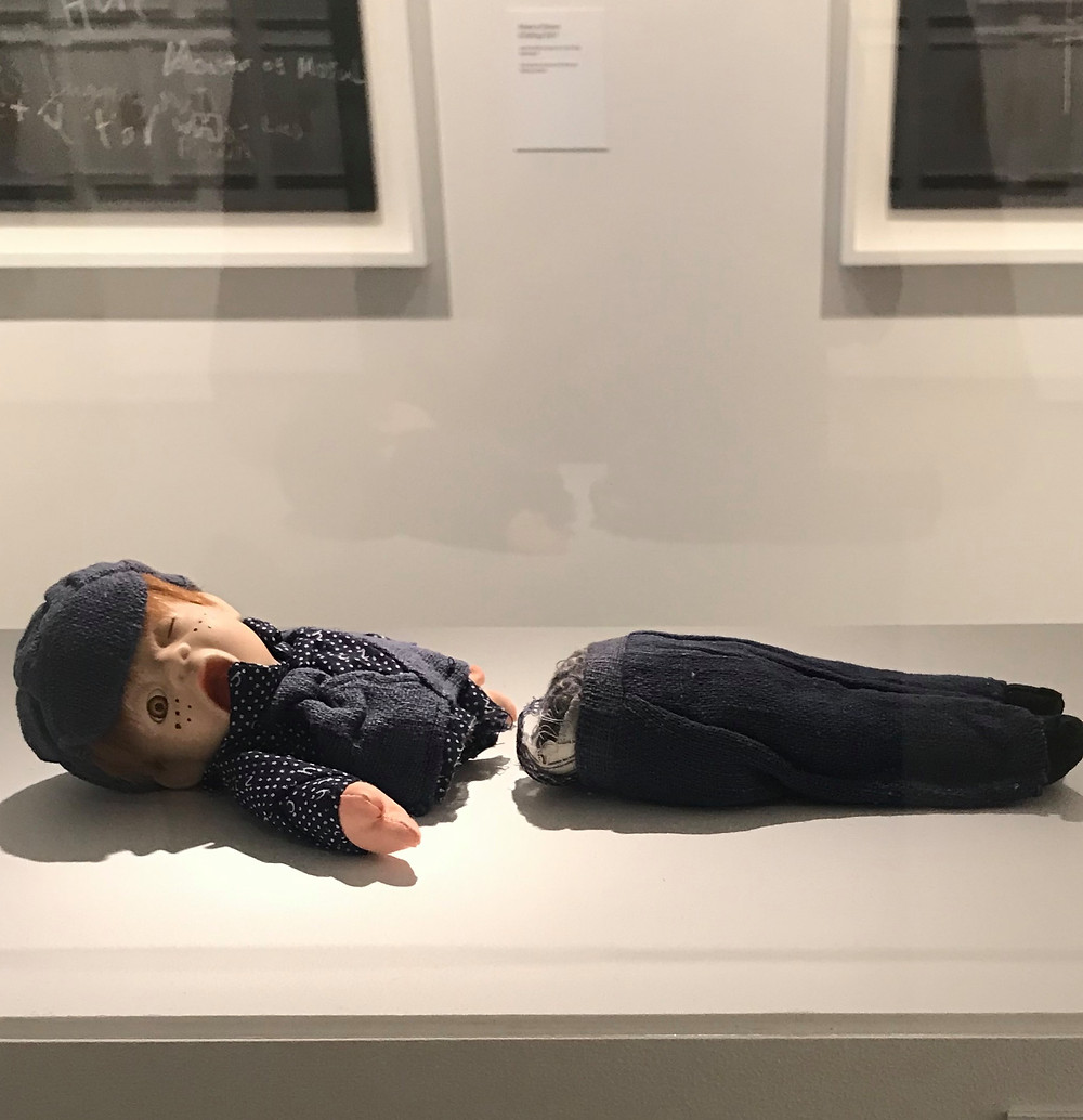 Doll bisected by a guillotine