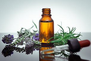 Essential oil bottle with rosemary and l
