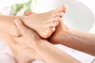 Pedicure and foot massage.Woman in a bea