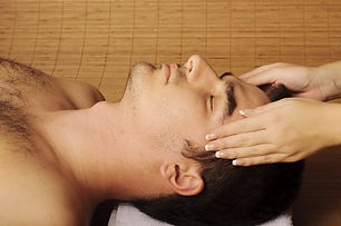 Young man getting face massage at spa.jp
