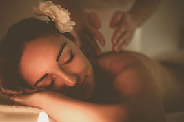 Woman during a massage treatment in spa.
