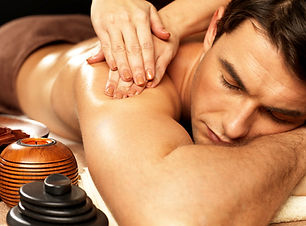 Masseur doing massage on man body in the