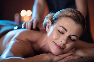 a middle aged woman lying on a massage t