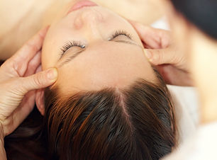 Therapist making acupressure head massage.jpg
