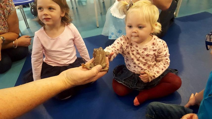 Pre-school children meeting Fiona the  frog
