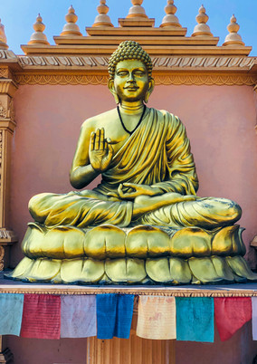 Canva - Golden Buddha Statue on Red and