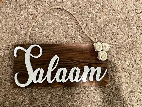 Salaam wood sign