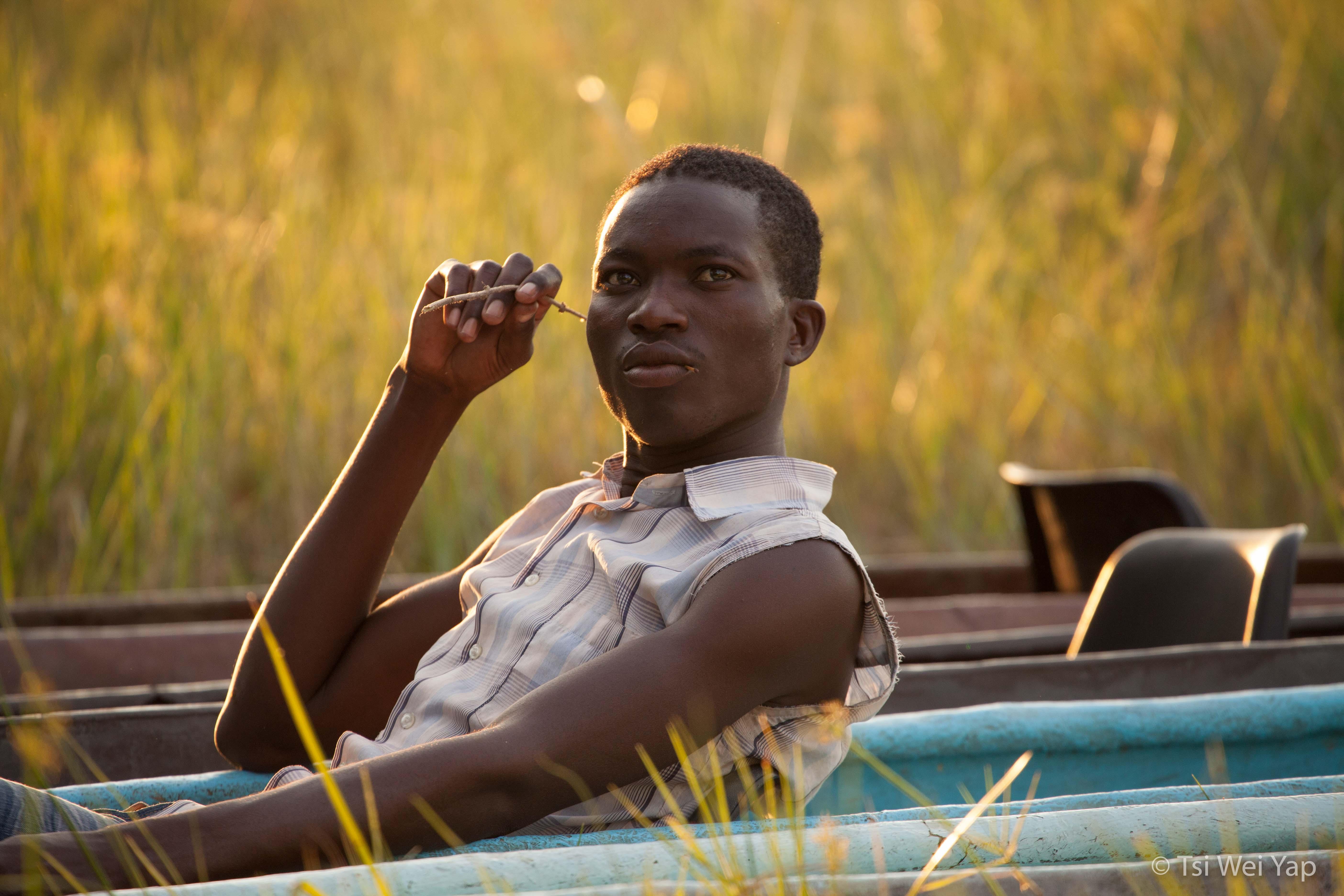 Mokoro Poler Resting - Okavango Delta