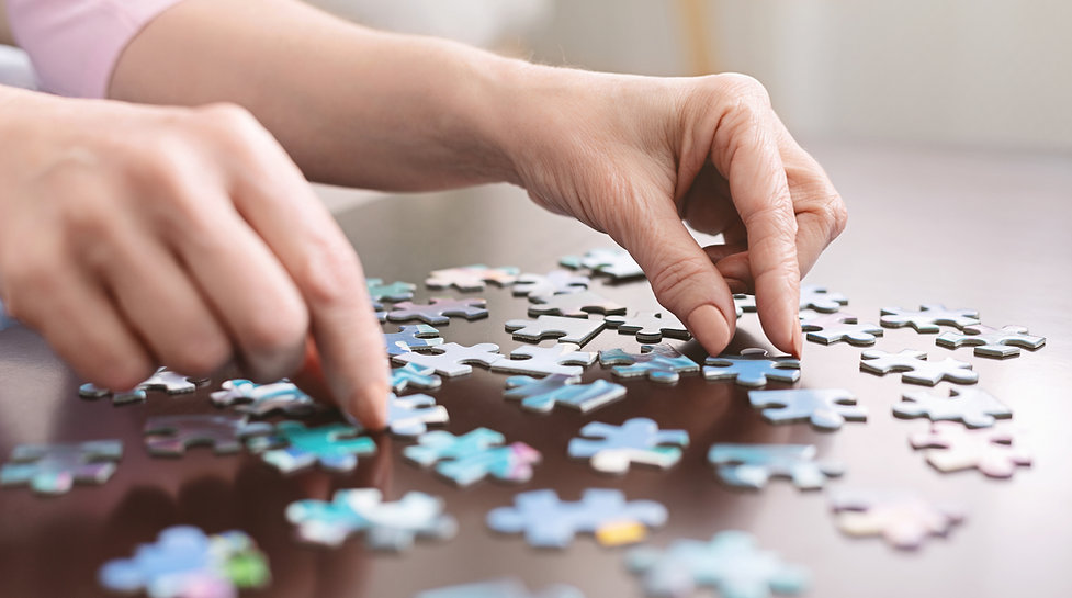 Senior with Alzheimers focused on puzzle .jpg