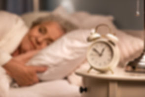 Lady sleeping alarm clock on nightstand