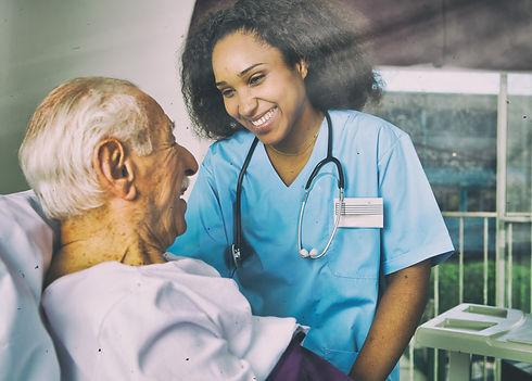Nurse laughing with senior iStock-114804
