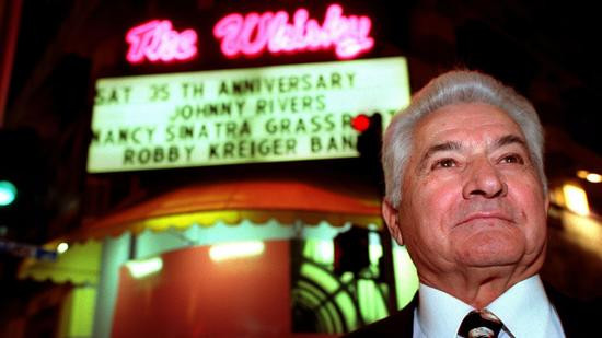 Mario Maglieri, who died Thursday at 93, stands outside the Whisky a Go Go during its 35th anniversary celebration in 1999. (Wally Skalij / Los Angeles Times)