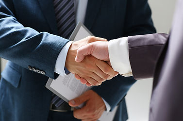 Man in suit shake hand as hello in offic